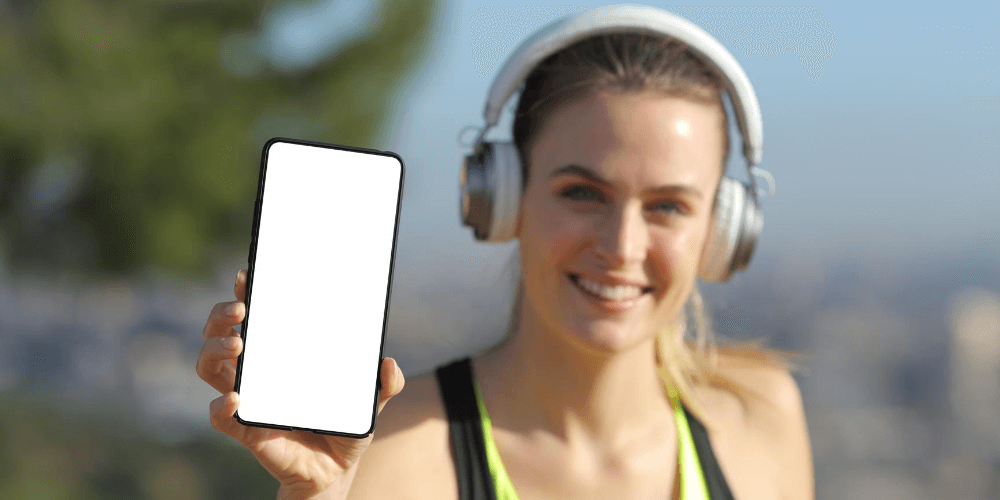 woman running with phone and headphones